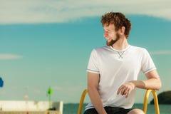 Fashion man relaxing enjoying summer outdoor. Stock Photography