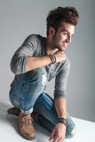 Fashion man relaxing on the floor while smiling Royalty Free Stock Images