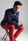 Fashion man resting on a stool Royalty Free Stock Photography