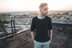 Fashion man on roof. Modern fashion man on roof sunset modern Stock Image