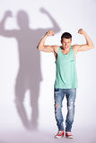 Fashion man showing biceps Royalty Free Stock Images