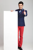 Fashion man showing the thumbs up sign Stock Photos