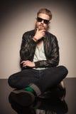 Fashion man sitting and thinking Stock Image