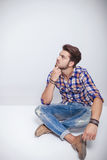 Fashion man sitting and thinking Royalty Free Stock Images