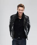 Fashion man smile over gray background. Fashion man, Handsome smile beauty male model portrait wear leather jacket, young guy over gray background Stock Photos