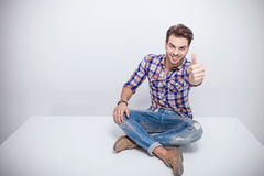 Fashion man smiling and showing the thumbs up gesture Royalty Free Stock Photo
