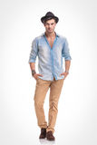 Fashion man standing with his hands in pockets Royalty Free Stock Photography