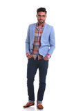 Fashion man standing with his hands in pockets Stock Photos