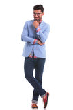 Fashion man standing with his legs crossed Royalty Free Stock Photo