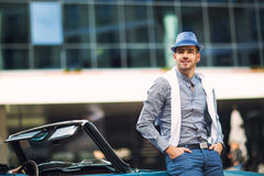 Fashion man standing near retro cabriolet car Stock Image
