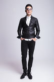 Fashion man standing on studio background Stock Images