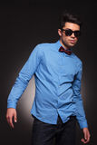 Fashion man in sunglasses posing Stock Images