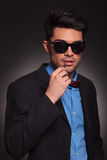 Fashion man with sunglasses ready for smoking Royalty Free Stock Photos