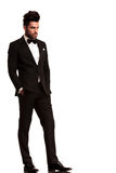 Fashion man in tuxedo looking to his side Stock Images