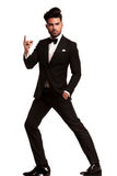 Fashion man in tuxedo snapping his finger Royalty Free Stock Photos
