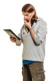 Fashion man using pc tablet browsing internet. Royalty Free Stock Image