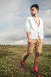 Fashion man walking on a field Stock Image