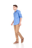 Fashion man walking on isolated background. Royalty Free Stock Images