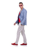 Fashion man walking and looking at the camera Royalty Free Stock Photo