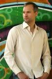 Fashion man at the wall stock image