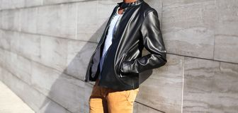 Fashion man wearing a black leather jacket in the city Stock Photography