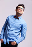 Fashion man wearing bow tie and glasses looks up Royalty Free Stock Photo