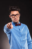 Fashion man wearing bow tie pointing Royalty Free Stock Images