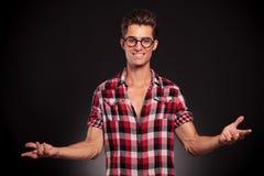 Fashion man wearing glasses welcoming Stock Photos