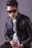 Fashion man wearing sunglasses and leather jacket Royalty Free Stock Photo
