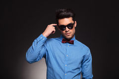 Fashion man wearing sunglasses thinking Royalty Free Stock Photography