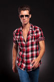 Fashion man wearing sunglasses walking forward Royalty Free Stock Image