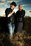 Fashion man and woman in field Royalty Free Stock Images