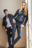 Fashion man and woman in leather clothes posing Royalty Free Stock Photo