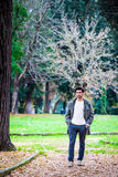 Fashion men autumn winter. Young man outdoors at park Royalty Free Stock Photos
