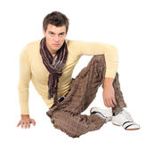 Fashion men pants, a shirt. With the white background. Guy sitting royalty free stock image