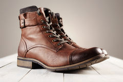 Fashion men`s boots.brown shoes still life Stock Images