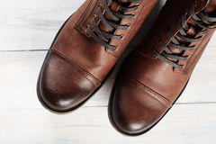 Fashion men`s boots.brown shoes still life Stock Photo