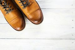 Fashion men`s boots. Yellow shoes. Yellow shoes. fashion men`s boots. trendy shoes still life on wooden background Royalty Free Stock Photography