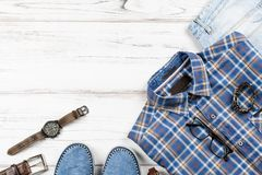 Fashion men`s clothing and accessories in casual style flat lay, copy space. Fashion men`s clothing and accessories in casual style flat lay royalty free stock photography