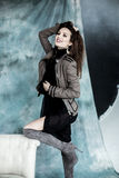 Fashion Military Style. Model in jacket, skirt and boots posing Stock Photography