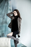 Fashion Military Style. Model in jacket, skirt and boots posing Royalty Free Stock Photo