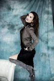 Fashion Military Style. Model in jacket, skirt and boots posing Stock Photo