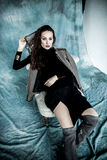 Fashion Military Style. Model in jacket, skirt and boots posing Royalty Free Stock Photos