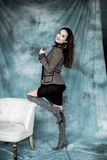 Fashion Military Style. Model in jacket, skirt and boots posing Royalty Free Stock Image
