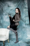 Fashion Military Style. Model in jacket, skirt and boots posing Stock Photos