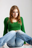 Fashion Model. Beautiful young fashion model seated on the floor Stock Photography