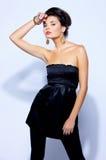 Fashion model. Fashion female model is posing in studio stock image