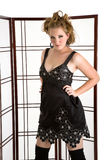 Fashion Model. Young Fasion Model in black silk dress Royalty Free Stock Images