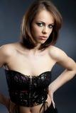 Fashion model. Young beautiful woman posing on grey background Stock Photo
