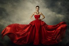 Fashion Model Art Dress, Elegant Woman Red Retro Gown. Fashion Model Art Dress, Elegant Woman Standing in Red Retro Gown, Silk Fabric Fluttering over Storm Sky stock photography